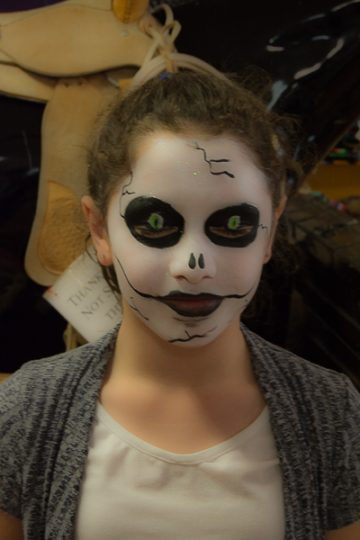 This young girl has her eyelids closed - awesome face painting!
