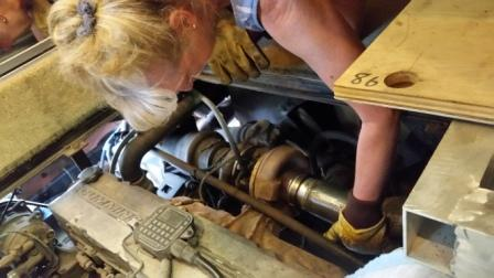 Sunny holds rebuilt exhaust pipe in place for Storm