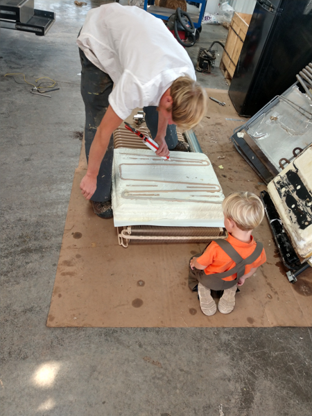 A young student of the refrigeration trade inspects our new coils