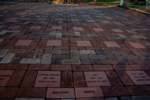 Church member names are engraved on bricks placed in the spot where they would have been seated