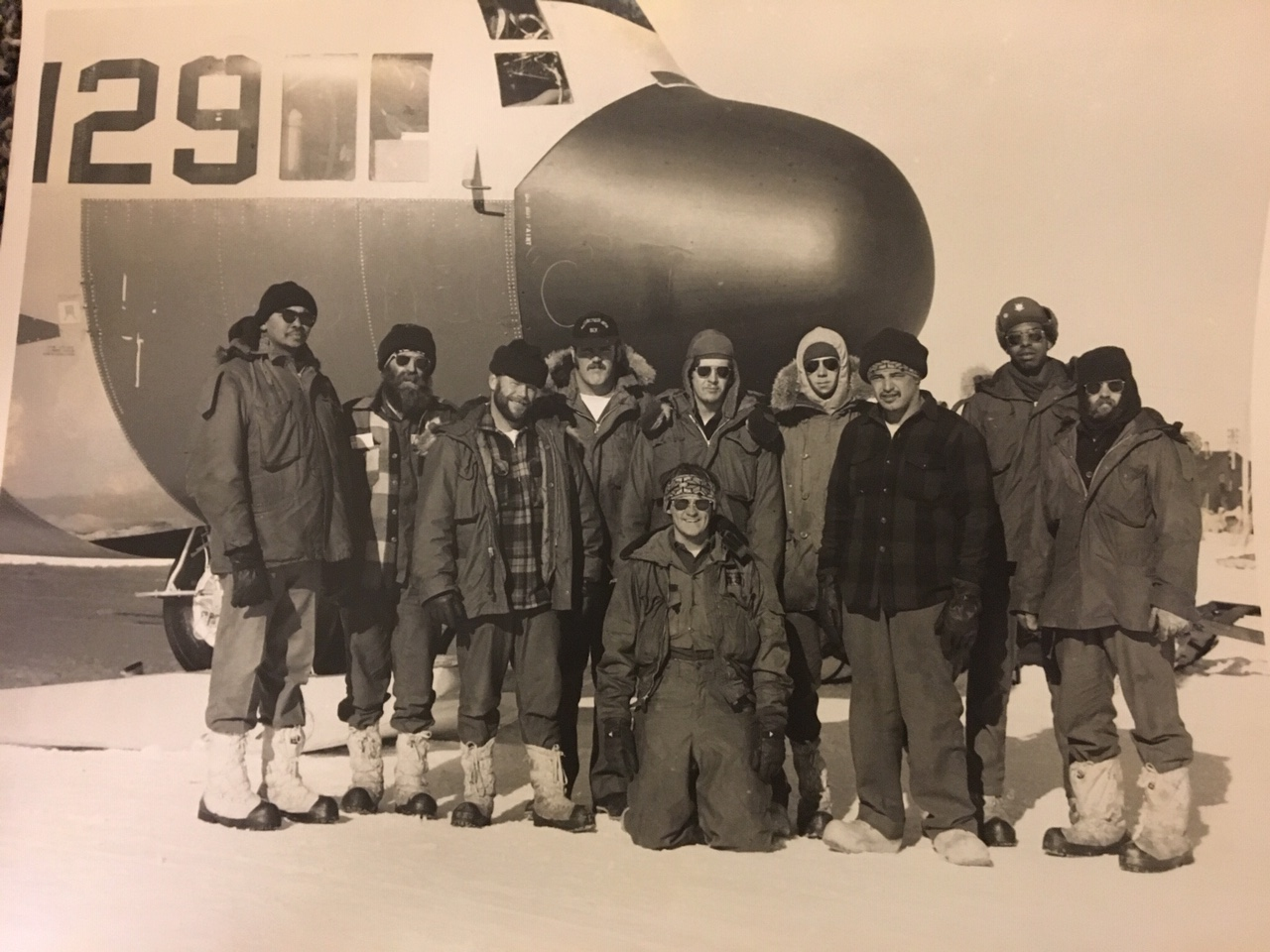 Navy aircraft repairmen - Steve is on the right. 159129 was taken at Dome Charlie just before it left for McMurdo.  Per Steve: The best I can find out, this plane is still going today.