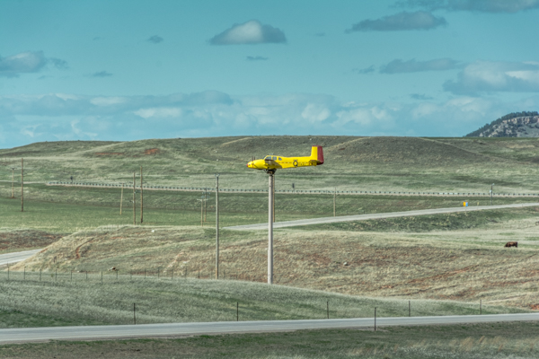 Wyoming Plane on a Pole - Props still turn and plane weathervanes into the wind (this day gusting to 40 mph along the interstate)