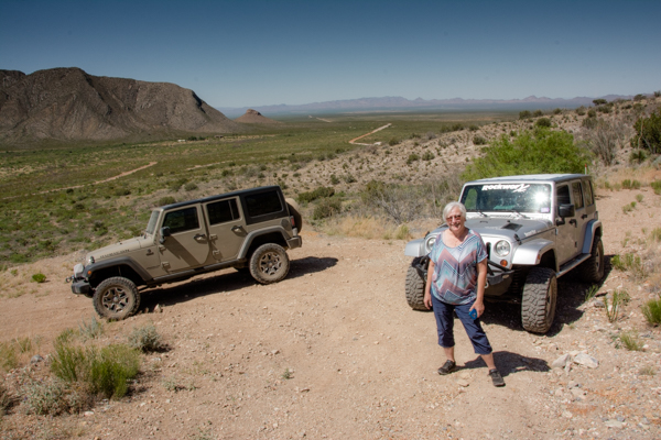 Jane explores an abandoned mine when a gate stops our ascent up this steep, curvy road.