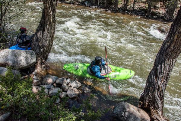 Once they strap their kayaks on, they hurl themselves off the bank into the river.