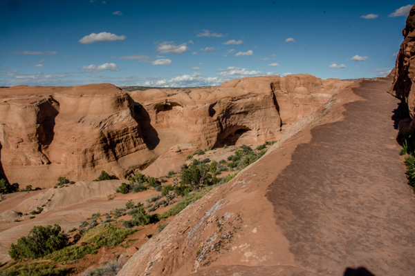 Then you navigate this narrow ledge walkway to Delicate Arch.